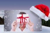 Composite image of man holding gift — Foto Stock