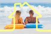 Cute couple in swimsuit sunbathing together — Stock Photo
