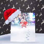 Composite image of santa hat on poster — Stock fotografie