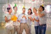 Casual business team celebrating with champagne — Stock Photo
