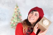 Brunette in hat listening gift — Stock Photo