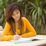 Female college student doing homework — Stock Photo #62653391