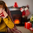 Cheerful redhead drinking hot drink at christmas — Stock Photo #62654967