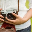 Mid section of woman holding vintage camera — Stock Photo #62657411
