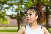 Healthy woman looking away in park — Stock Photo