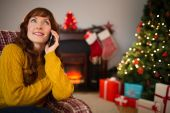 Pretty redhead on the phone at christmas — Stock Photo