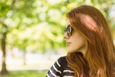 Woman looking away in park — Stock Photo