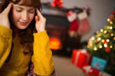 Redhead getting a headache on christmas day — Stock Photo