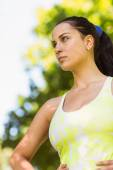 Focused fit brunette in the park — Stock Photo