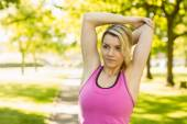 Fit blonde stretching in the park — Stock Photo