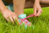 Fit woman tying her shoelace  — Stock Photo