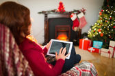 Redhead touching digital tablet at christmas — Stock Photo
