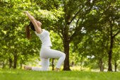 Woman doing stretching exercises at park — Stock Photo