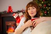 Pretty redhead holding a mug at christmas — Stock Photo