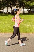 Fit brunette jogging on path — Foto de Stock