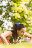 Fit determined brunette doing push ups — Stok fotoğraf