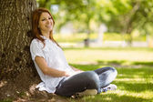 Pretty redhead sitting in casual clothing — Stock Photo