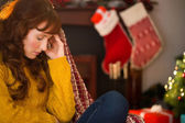 Beauty redhead getting headache at christmas — Stock Photo