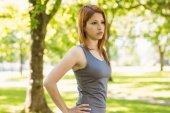 Pretty redhead resting in park — Foto Stock
