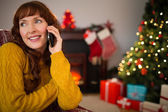 Smiling red air on the phone at christmas — Foto de Stock
