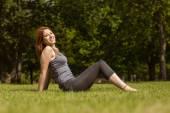 Portrait of a pretty redhead sitting carefree — Stock Photo