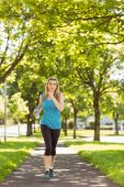 Fit blonde jogging in the park — Stock Photo