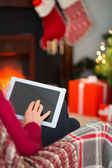 Red hair touching digital tablet at christmas — Stock Photo