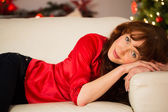 Portrait of a pretty redhead relaxing at christmas — Stock Photo