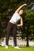 Woman doing stretching exercises in park — Stock Photo