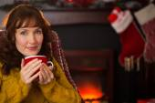Smiling red hair enjoying hot drink at christmas — Stock Photo