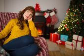 Pretty redhead thinking and relaxing at christmas — Stock Photo