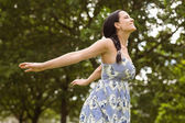 Peaceful brunette in dress standing — Stock Photo