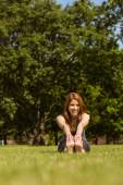 Portrait of a pretty redhead smiling stretching — Stock Photo
