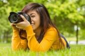 Female photographer at park — Stock Photo