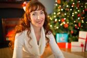 Redhead woman sitting on floor using laptop at christmas — Foto de Stock