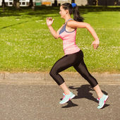 Fit brunette going faster on path — Stock Photo