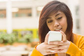 Beautiful young woman text messaging — Stock Photo