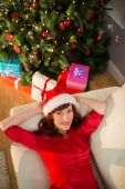 Pretty redhead relaxing on the couch at christmas — Stock Photo