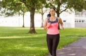 Fit brunette jogging in the park — Photo
