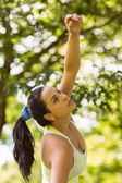 Concentrated fit brunette stretching in the park — Stock Photo