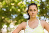 Focused athletic brunette in the park — Stock Photo