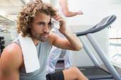 Handsome tired young man in gym — Foto de Stock