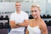 Portrait of a sporty couple at fitness studio — Stock fotografie