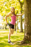 Fit blonde stretching her leg — Stock Photo