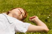 Pretty redhead napping on grass — Stock Photo