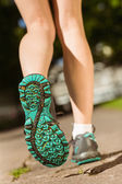 Woman in running shoes stepping on path — Stock Photo