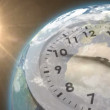 Clock ticking against sun on the earth — Vídeo stock #64754905