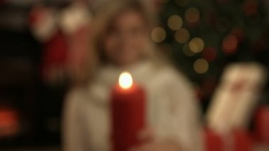 Pretty blonde showing a candle — Stock Video
