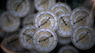 Hanging pocket watches ticking in shadows — Vídeo de Stock