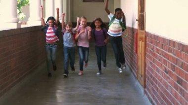Cute pupils running in hallway — Stock Video